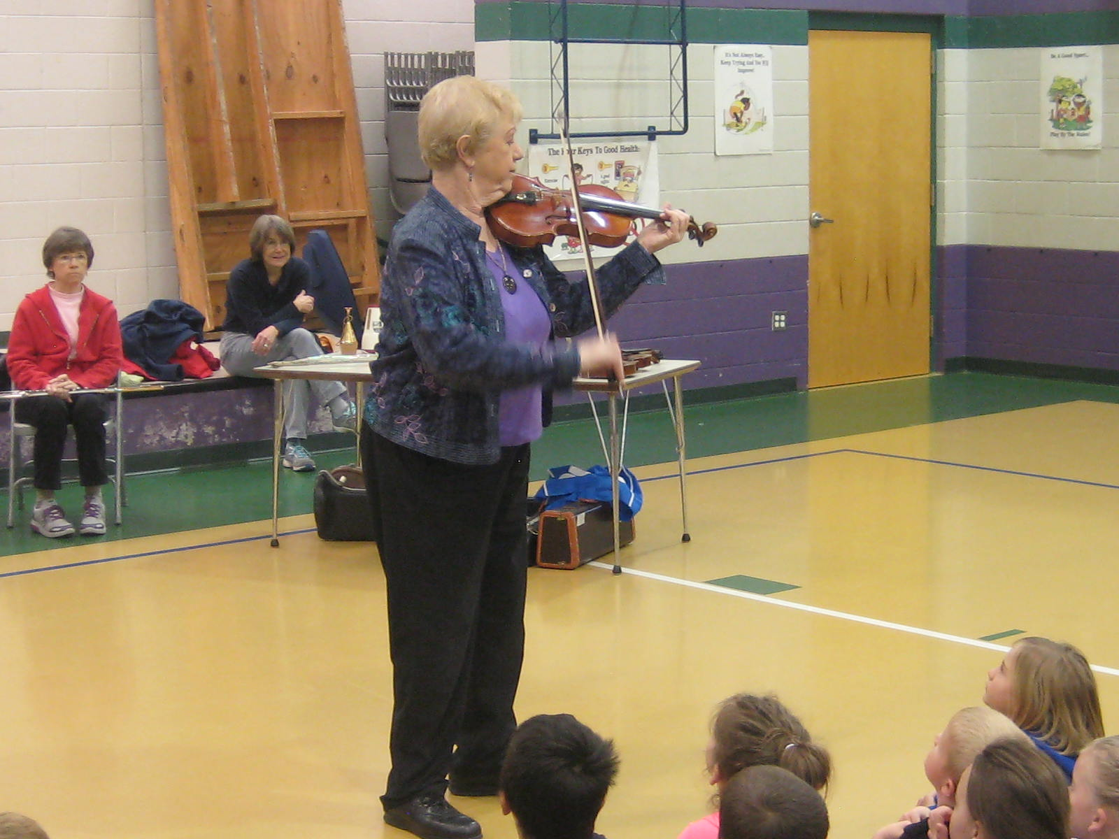 Lorraine Fink plays the violin for the Rosman Elem  Kindergarten class 2