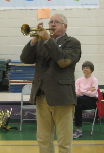 Don Wauchope demonstrates the trumpet for Rosman Elem Kindergarteners