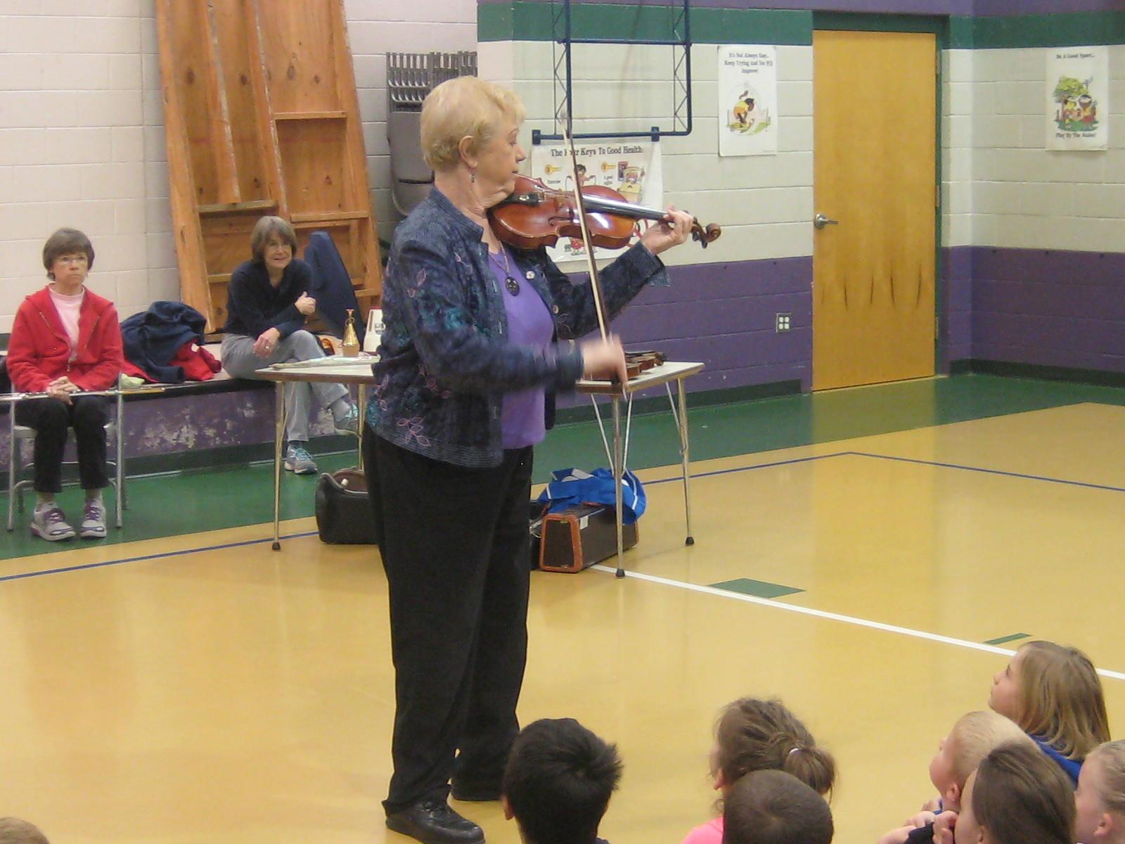 Lorraine Fink plays the violin for the Rosman Elem  Kindergarten class 2