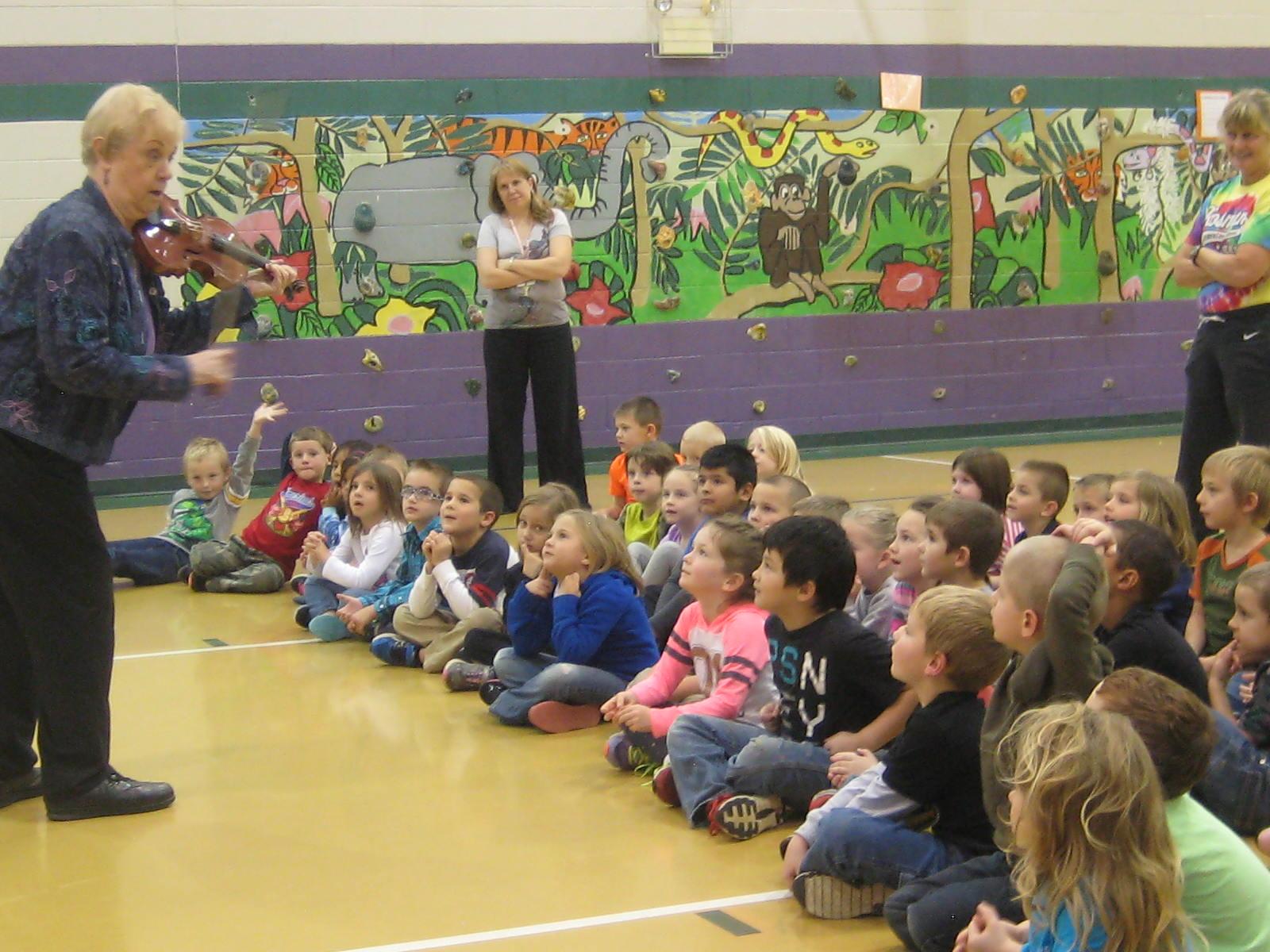 Lorraine Fink plays the violin for the Rosman Elem  Kindergarten class